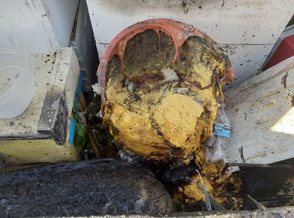 Burned bucket and truck.JPG